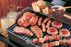 hot dogs, hamburgers, shish kebab, chicken, and steaks on the grill